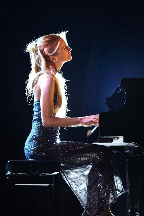 Woman playing a beautiful composition on a grand piano