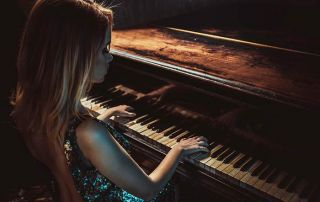 elegant woman playing the piano feat