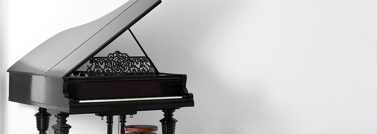 grand piano in white room