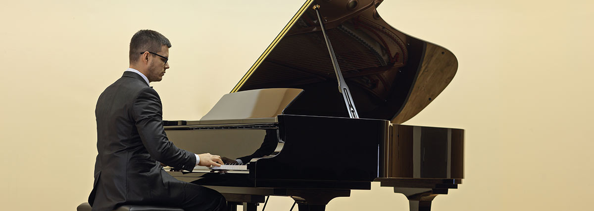 man playing the grand piano