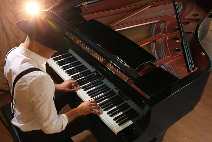man performing on the piano feat