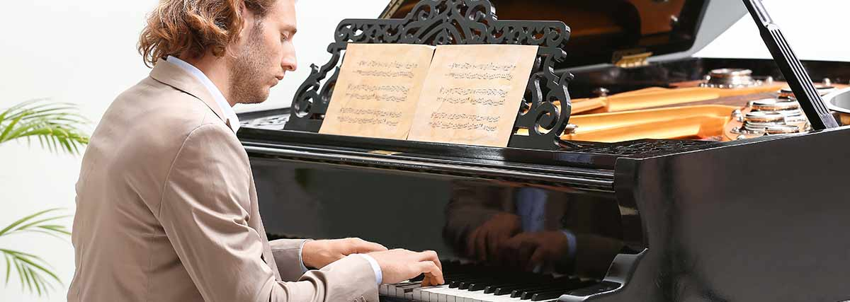 man playing on the grand piano